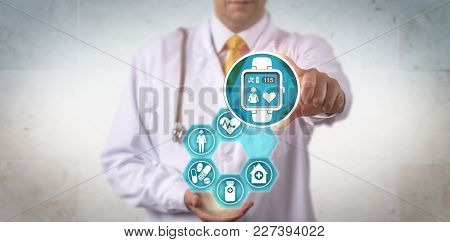 Unrecognizable Doctor Of Medicine Is Recommending A Smart Watch With A Pulse Trace App. Healthcare E