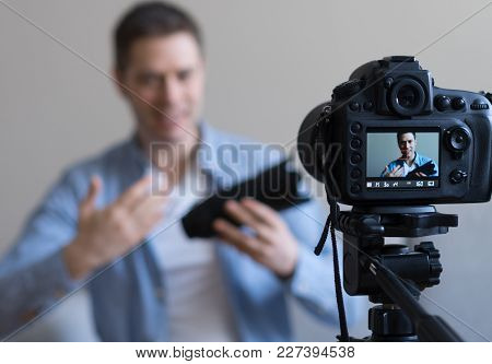 Man Making Video Blog About Photo Camera Lenses. Focus On Camera.