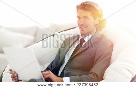 close-up of smiling businesswoman working with laptop in living