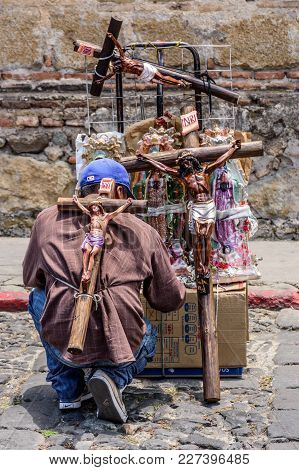 Antigua, Guatemala -  April 13, 2017: Street Seller Of Religious Icons On Holy Thursday In Town With