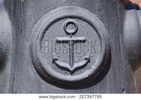 Icon Of The Sea Anchor On The Concrete. Symbol Of Seamen