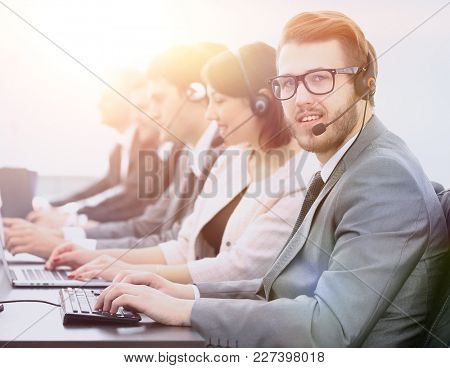 operator call center with colleagues sitting at the workplace