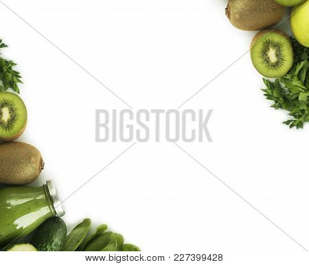 Green Smoothie With Apples, Parsley, Spinach, Cucumber And Kiwi On A White Background. Top View. Spi