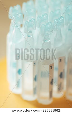 Sodium chloride saline ampoules for babies, selective focus poster