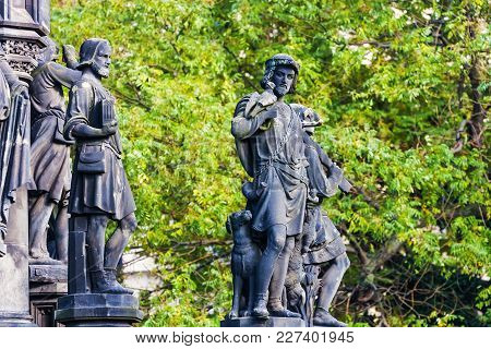 Sculpture Or Statue Of A Men Hunters With Gun And Dog In The Park