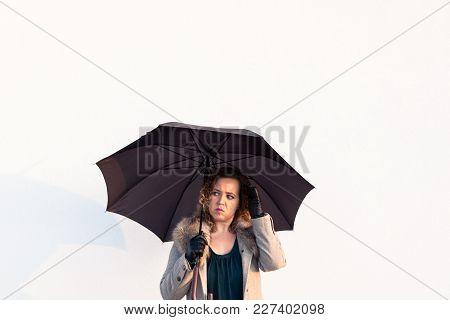 Curly Beautiful  Elegant Woman Holding Umbrella On White Background Outdoor