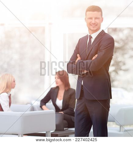 successful businessman standing in the lobby of his office.