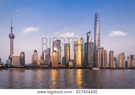 Beautiful Cityscape With Glass Skyscrapers Standing Along The Huangpu River Against The Backdrop Of