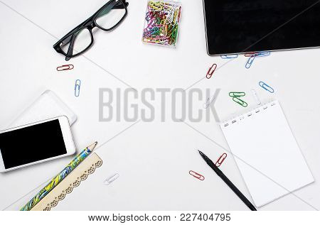Workplace With Blank Tablet, Notepad And Pen, Smartphone And Glasses  On The White Background Office