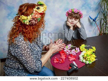 Mother And Daughter Are Engaged In Needlework. They Make Wreaths For The Head.
