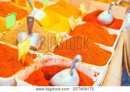 Piles Of Colorful Spices On The Traditional Arabian Market In Israel. Selective Focus