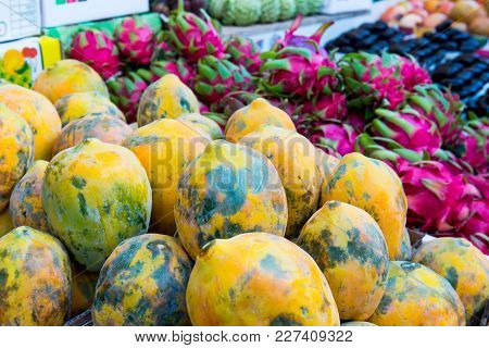 Close Up Fresh Exotic Fruits In A Market Display. Selective Focus