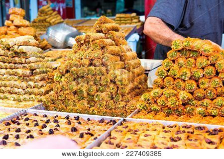 Variety Of Sweets On The Arab Street Market Stall. Eastern Sweets In A Wide Range, Baklava, Turkish