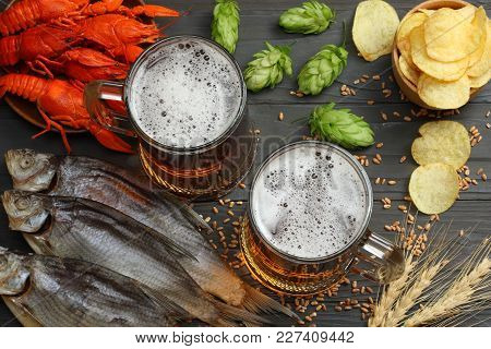 Glass Beer With Crawfish, Dried Fish And Wheat Ears On Dark Wooden Background. Beer Brewery Concept.