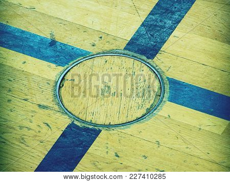 Recessed Floor Lid  For Training Equipment, Detail In Floor Of School Gym. Black Painted Cross On Wo