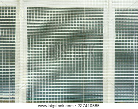Safety Protection Of  Windows In Sporting Hall. Window Covered  With Woven Safety Net. Reflection In