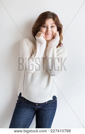 Fashion, Party, Playing Concept. On The Backgrounf Of Studio White Wall There Is Extremely Cute Woma