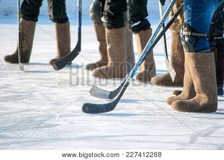 Ice Hockey In Felt Boots, Horizontal Shot Of The Legs Of The Sport Team. Russia, Kaliningrad Region,
