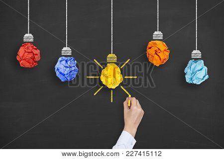 Idea Concept Light Bulb Crumpled Paper On Blackboard