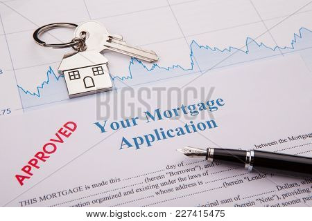 Blue Ballpoint Pen On A Mortgage Application Form