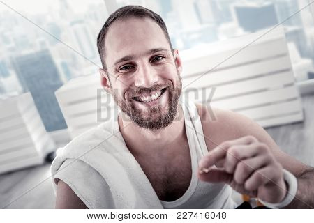 Great Training. Attractive Happy Adorable Sportsman Grinning While Posing On The Blurred Background