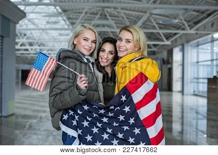 Portrait Of Female Companions Enfolding Their Bodies With Banner Of United States Of America. They A
