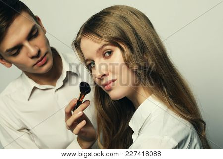 make-up artist doing make-up beautiful girl, beauty concept and