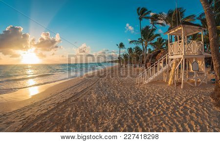 Punta Cana Sunrise Over Caribbean Beach With Lifeguard Station.