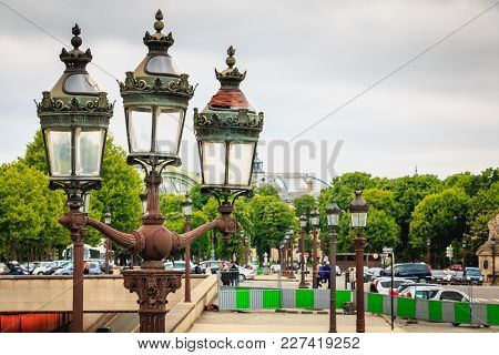 Paris, France - May 08, 2017 : Lanterns Of The Place De Concorde A Gray Spring Day, Formerly Running