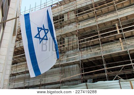 An Israeli Flag On The Background Of A Building Under Construction