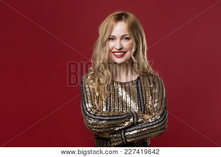 Waist Up Portrait Of Content Pretty Woman Standing With Arms Crossed And Laughing. Copy Space In Lef