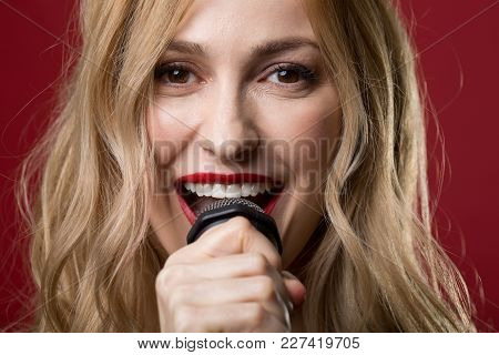 Close Up Portrait Of Female Expression Chanting A Song And Looking At Camera With Joy. Isolated On R