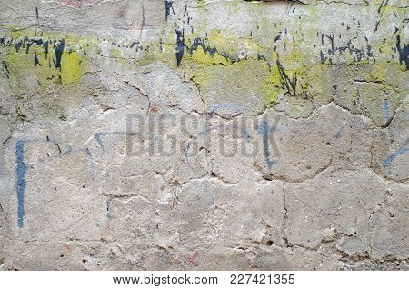 Old Grey Concrete Garage Wall With Spots Of Black And Green Paint Abstract Background