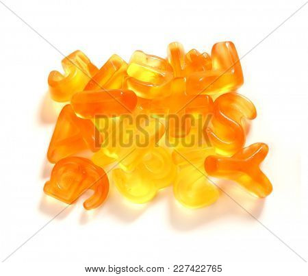 Yellow candy. Gelatin candies. Alphabet.