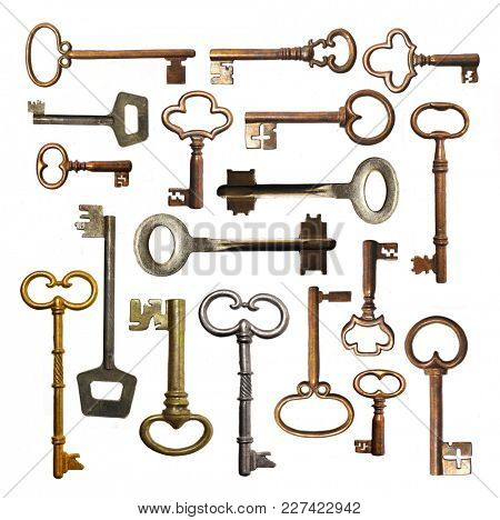 Collection of old keys on a white background