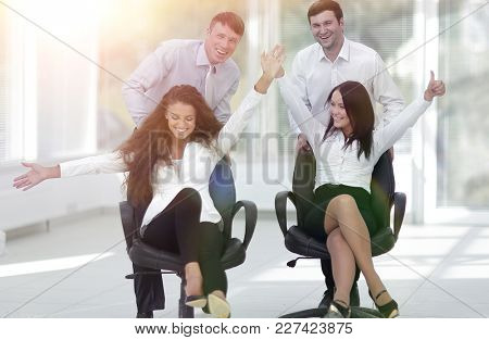 enthusiastic business team in office