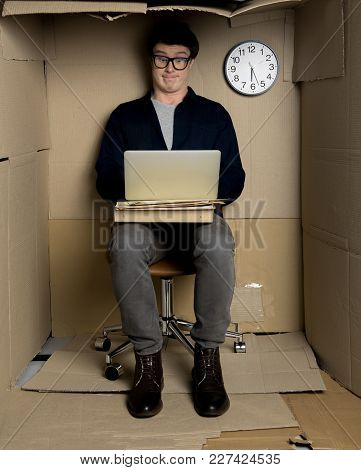 Shocked News Concept. Full Length Portrait Of Surprised Man In Glasses Is Using Laptop While Sitting