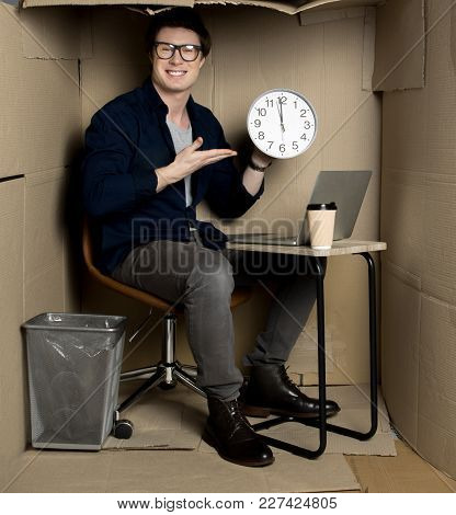 Lunch Time. Full Length Portrait Of Happy Young Employee Is Sitting At Table In Cardboard Office And