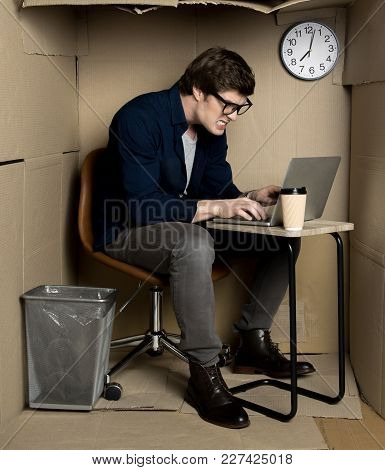 Feeling Furious. Full Length Of Young Employee Is Expressing Anger While Typing On Modern Laptop. He