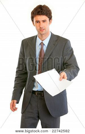 Displeased modern businessman showing document isolated on white poster