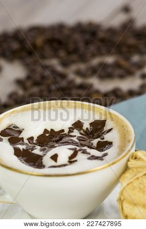 Porcelain Cup And Saucer Of Delicious Freshly Made Aromatic Cappuccino Topped With Milky Foam And Ch