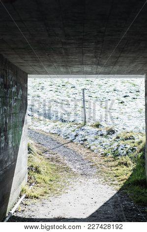 Darken Concrete Tunnel To A Snow Meadow