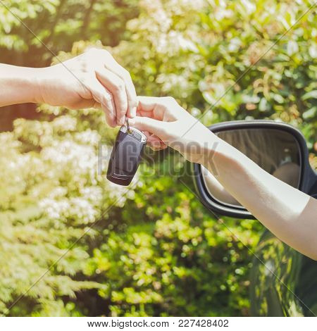 Young Smiling Woman Sitting In Car Taking Key Handover Rent  Purchase