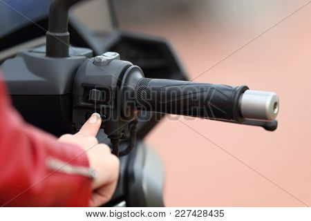 Close Up Of A Motorbiker Hand Starting Engine Of A Motorbike