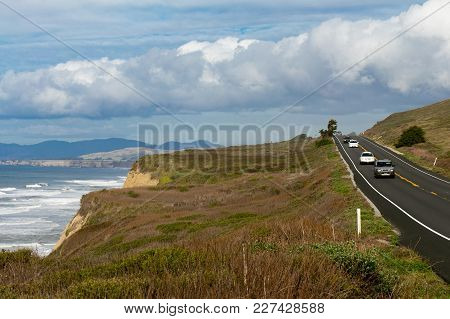 Lanscape Photo Of Cars Driving On Beautiful California Coastal Highway One, In San Francisco Bay Are