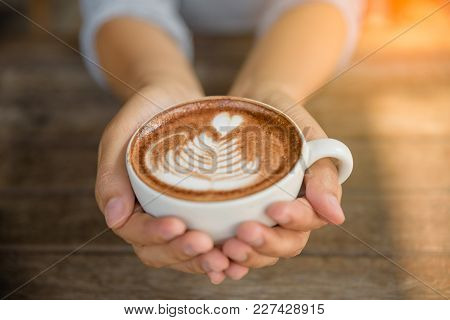 Woman Hands Holding Cup Of Hot Coffee Latte Cappuccino With Heart Shaped. Love, Wedding And Valentin