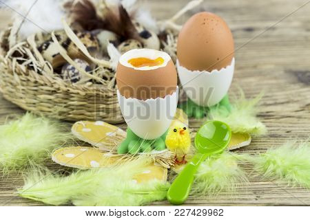 Hard Boiled Egg For Easter Morning Breakfast Served In A Cute Egg Cup With Feet On A Floral Mat With