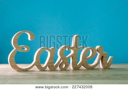 Easter - Word Corved Of Wood. Happy Easter, Holiday Concept, 1st April 2018.