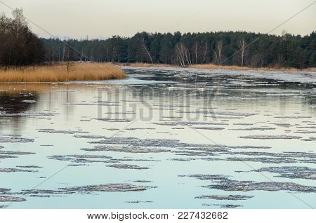 The Ice Floes On The River In Winter.