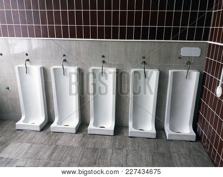 Close Up Row Of Outdoor Urinals Men Public Toilet